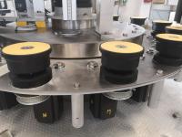 Sistema di movimentazione piattelli portabottiglie a camma con doppio profilo in bagno d'olio o con movimentazione a controllo elettronico programmabile MP
