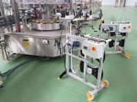Dévidoir motorisé à double bobine pour alimentation du poste autocollant